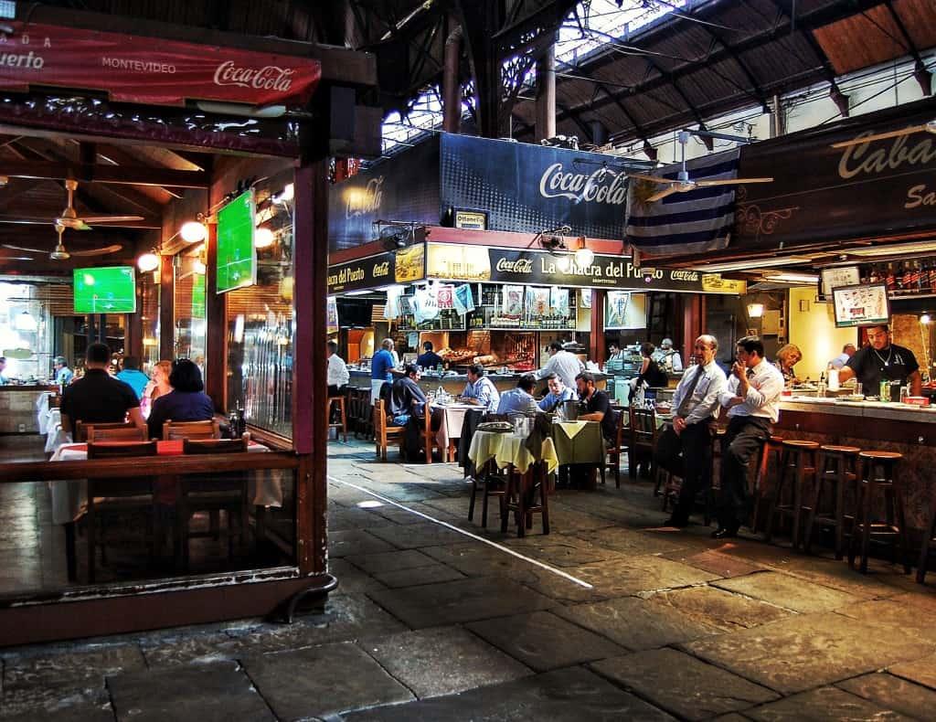Uruguay - Monevideo - Mercado del Puerto market restaurants in an old train station barbecue meat