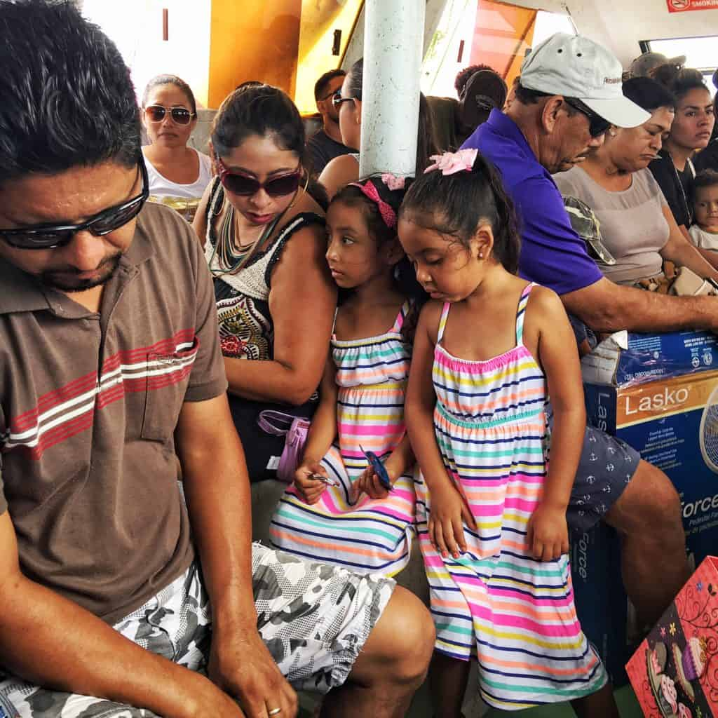 A crowded water taxi back to Belize City