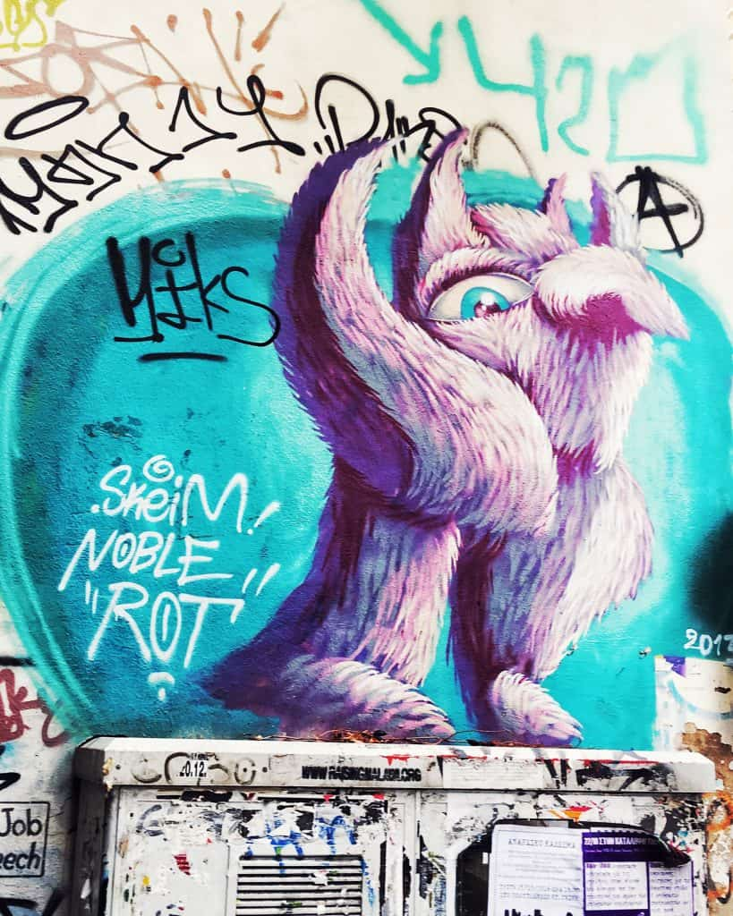 A small painting in Exarchia. Possibly the one-eyed, one-horned, flying purple people eater?