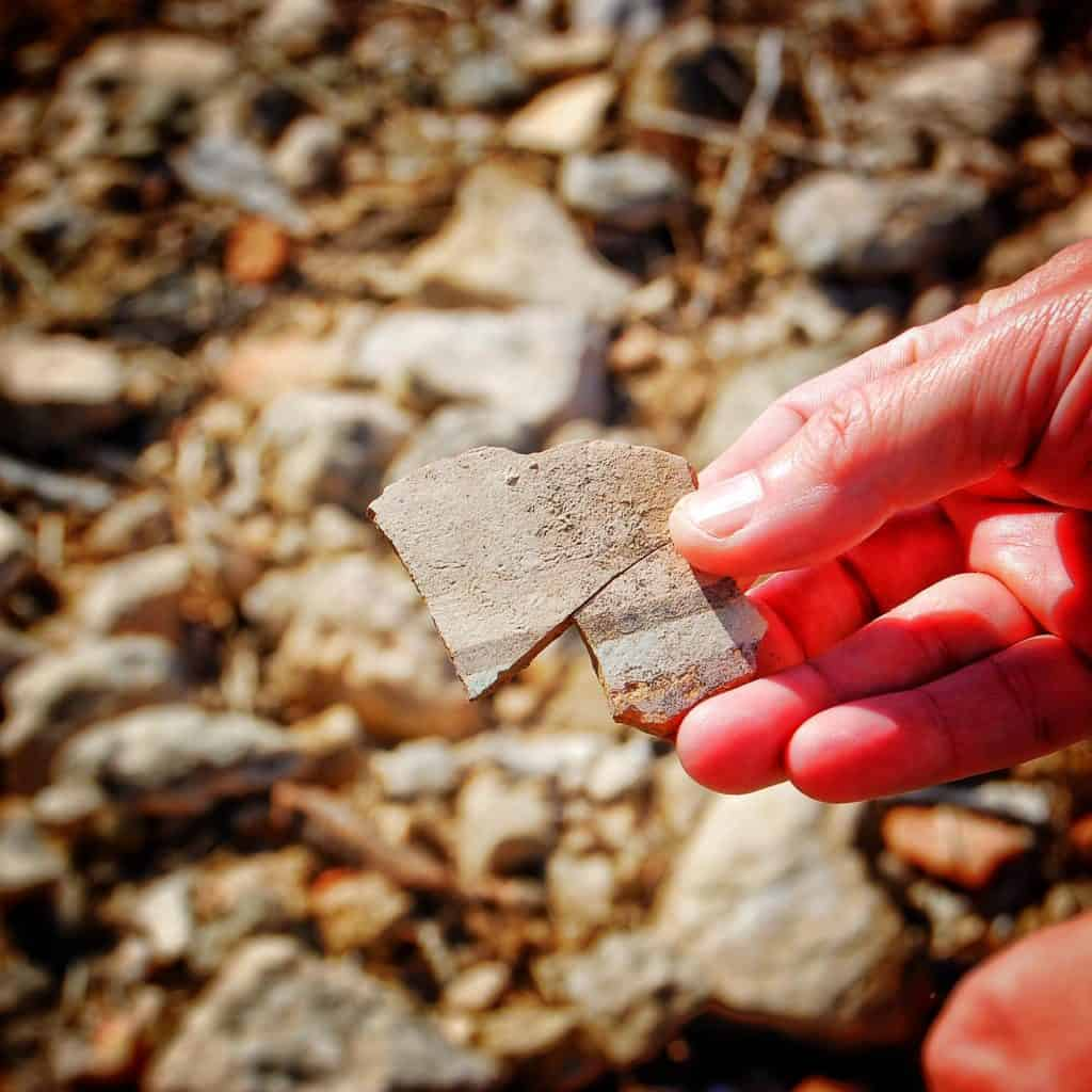 On a trip to Italy, one of the members of our tour is a working archaeologist in real life. He found these two twelfth century shards of pottery and fit them back together. The viewer can imagine its them holding the pottery and even what it would feel like in their hands.