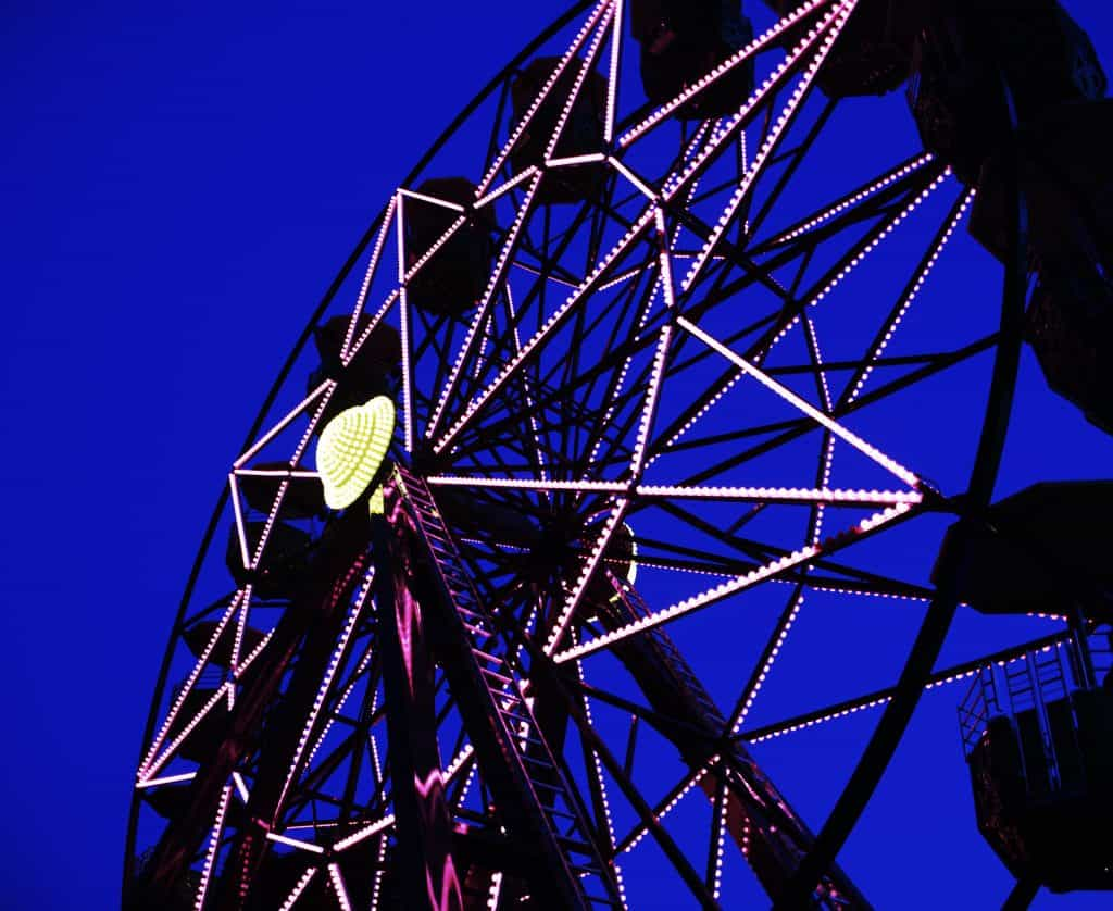 This photograph mixes the light from the ferris wheel with the last natural light of the day.