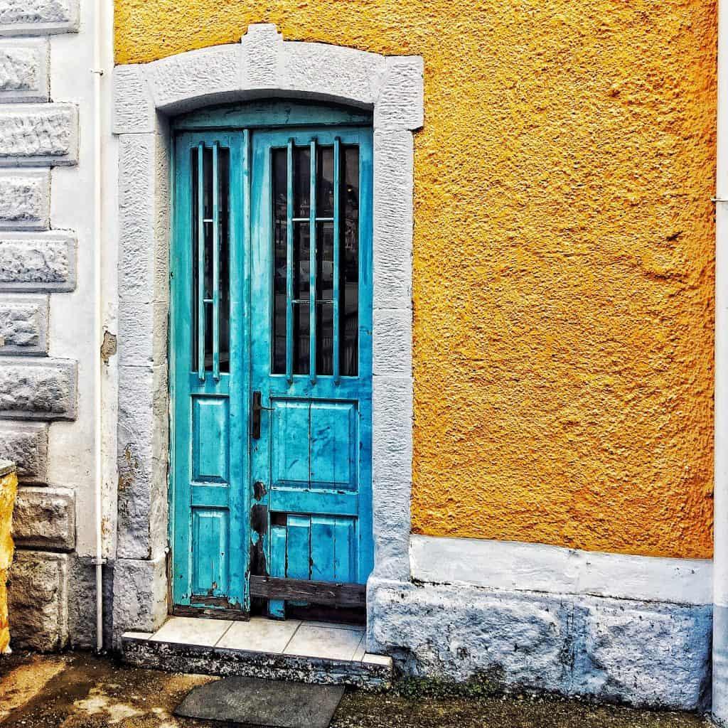 A yellow door at the Kalabaka train station