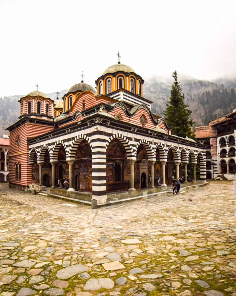 The Nativity of the Holy Virgin Church at Rila Monastery, a brightly painted church contracted of stone and wood.