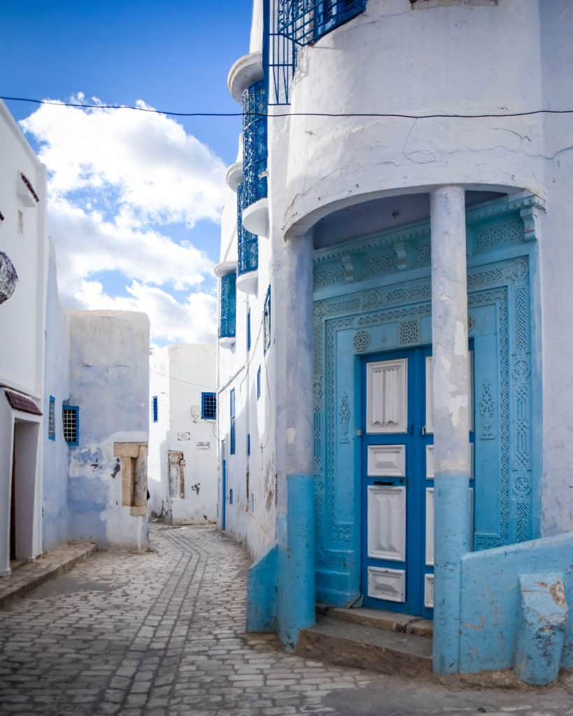 Like the town of Sidi Bou Said, Kairouan's medina is also blue and white. But I found it far less touristy and a little more interesting. - Photographs of Tunisia Historical Sites