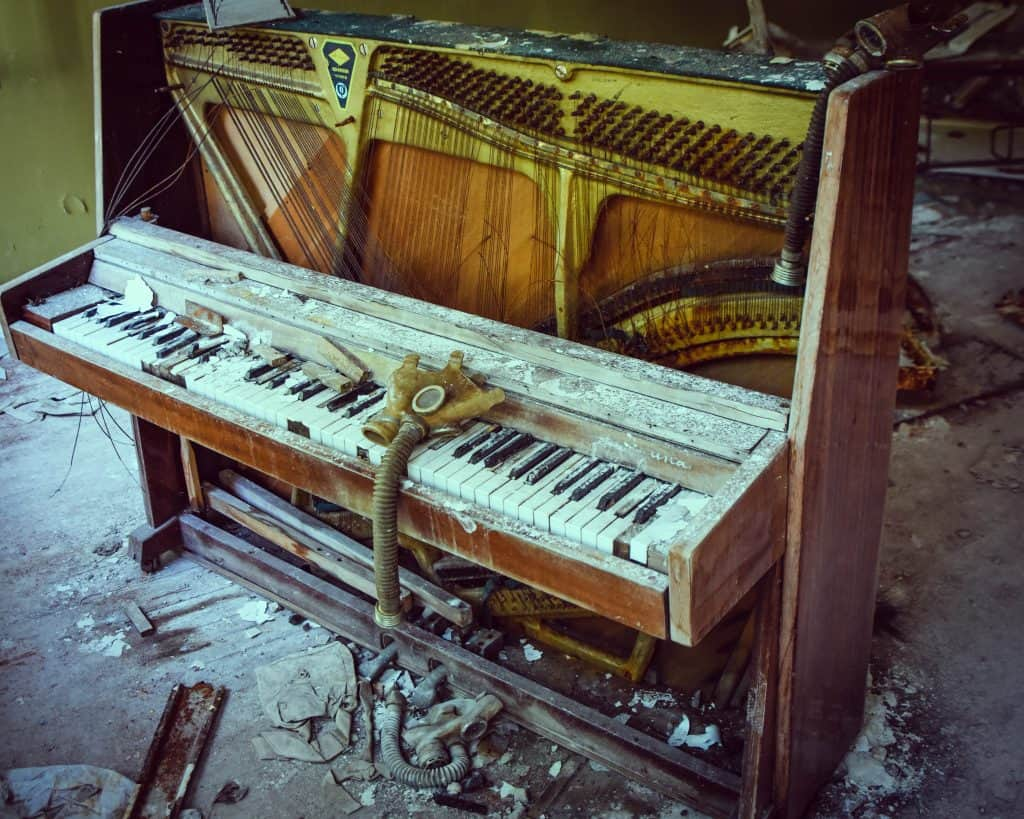 Gas masks artfully strewn over a piano in Chernobyl. So many places seemed like the tourists were more focused on taking pictures of Chernobyl than learning from it.