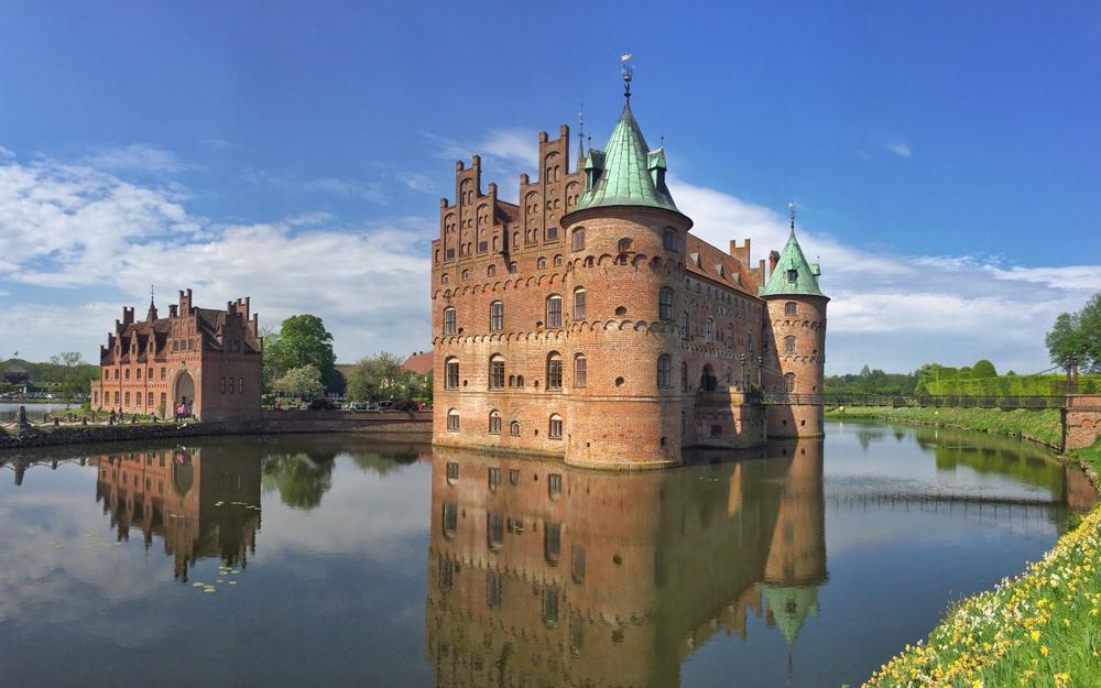 Egeskov Castle (Danish: Egeskov Slot) is located near Kværndrup, in the south of the island of Funen (Fyn), Denmark. The castle is Europe's best preserved Renaissance water castle.