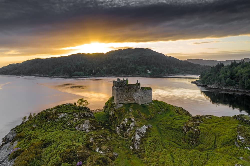 Aerial drone shot of Castle Tioram, it is a ruined castle that sits on the tidal island Eilean Tioram in Loch Moidart, Lochaber, Highland, Scotland. It is located west of Acharacle, approximately 80 k