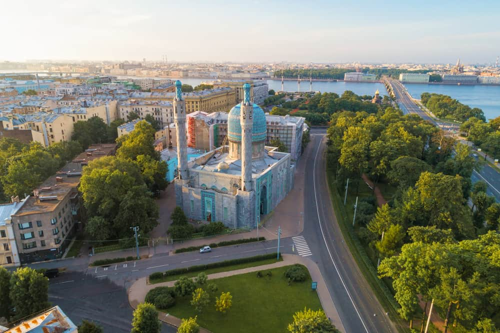 The building of an old mosque in the cityscape on a July morning (aerial photography). Saint-Petersburg, Russia