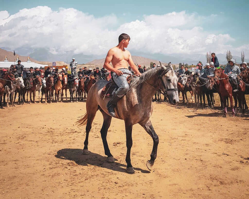 Planning on exploring Kyrgyzstan on horseback and shirtless? Get travel insurance just in case of an emergency.