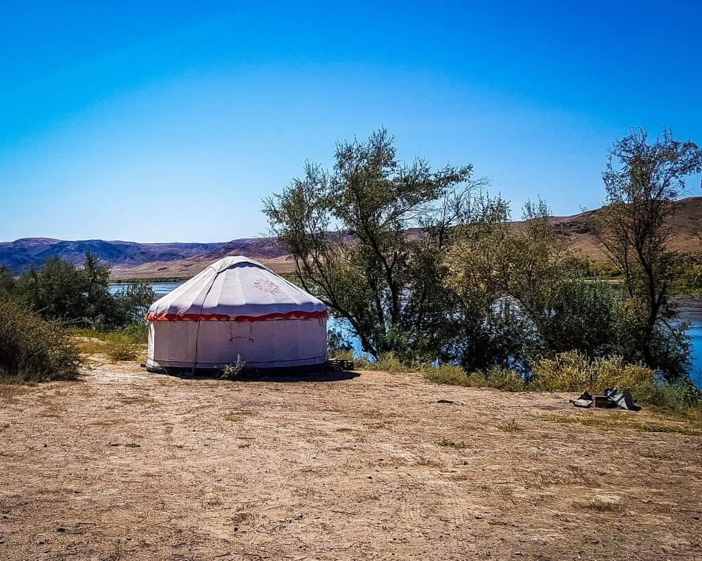 A yurt sitting beside the Ili River in Tamgaly