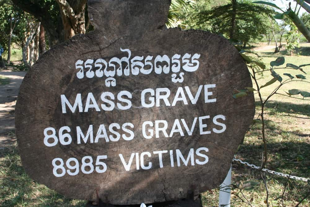 Cambodia - Phnom Penh - mass grave sign at the killing fields in cambodia. Where more than 8900 victims, including women and children, were brutally murdered and buried in mass graves