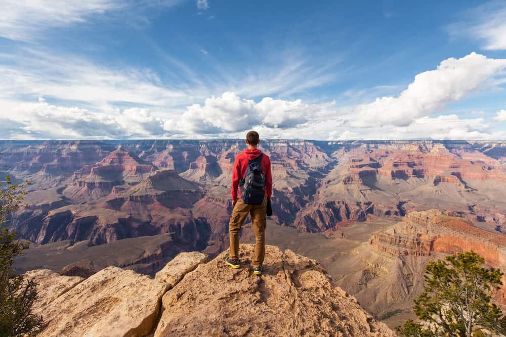 USA - Arizona - Travel in Grand Canyon, man Hiker with backpack enjoying view, USA
