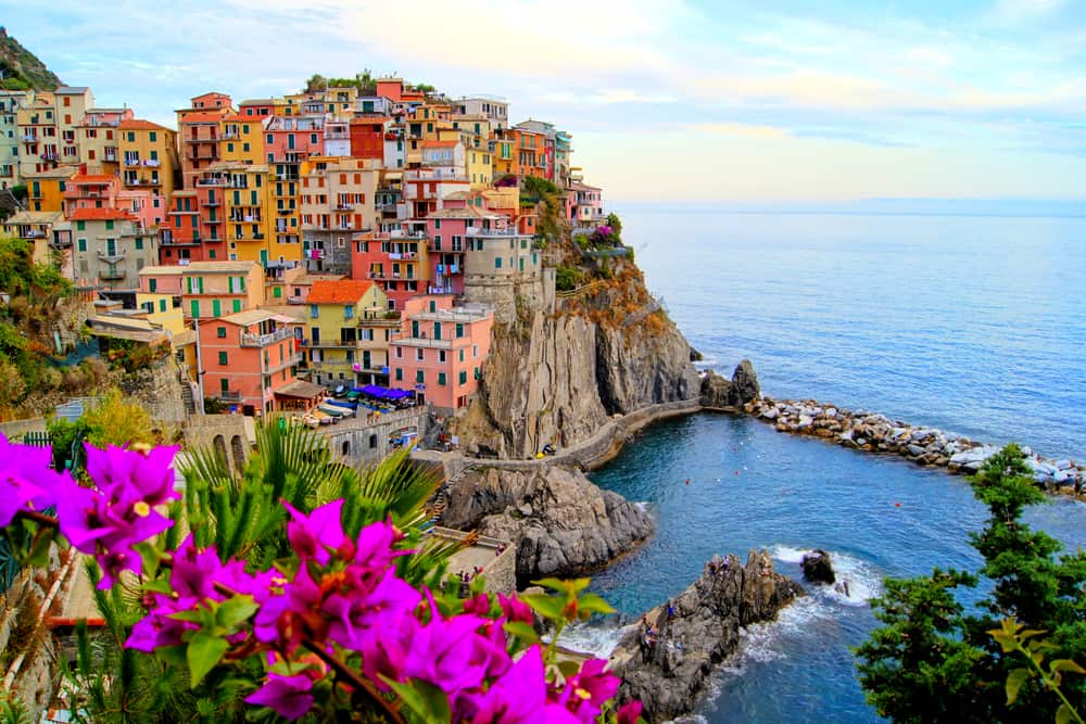 Village of Manarola, on the Cinque Terre coast of Italy with flowers