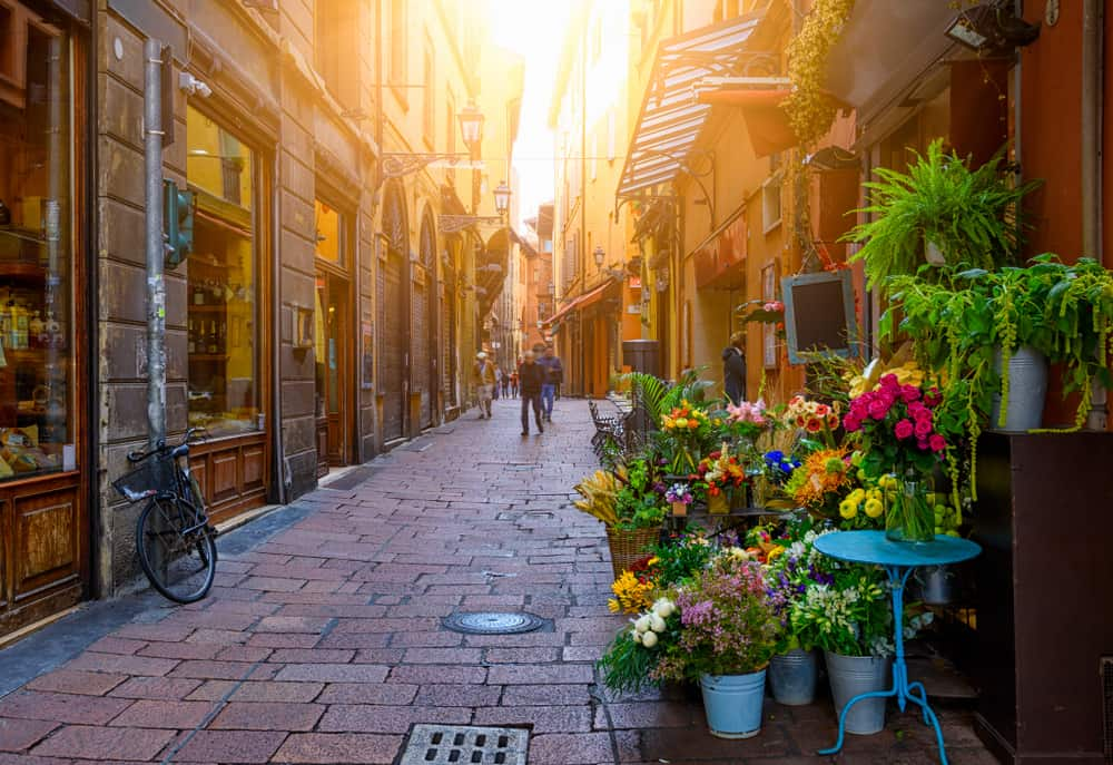 Old narrow street with flower shop in Bologna, Emilia Romagna, Italy. Cityscape of Bologna