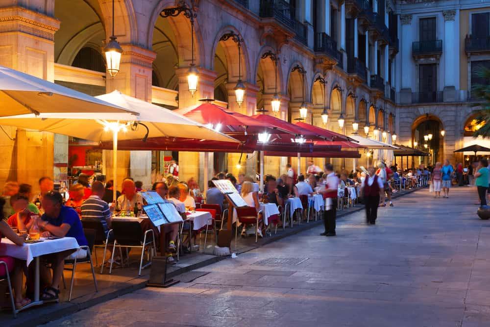 Street restaurants at Placa Reial in summer night. Barcelona, Spain