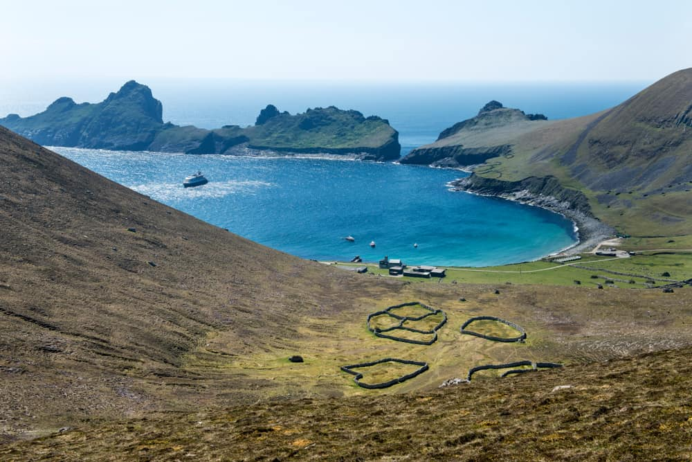 UK - Scotland - Village Bay on the remote and abandoned Hebridean island of Hirta, St Kilda, Outer Hebrides, Scotland. In the foreground walled crop growing areas and in the background the island of Dun. UNESCO site. - Image