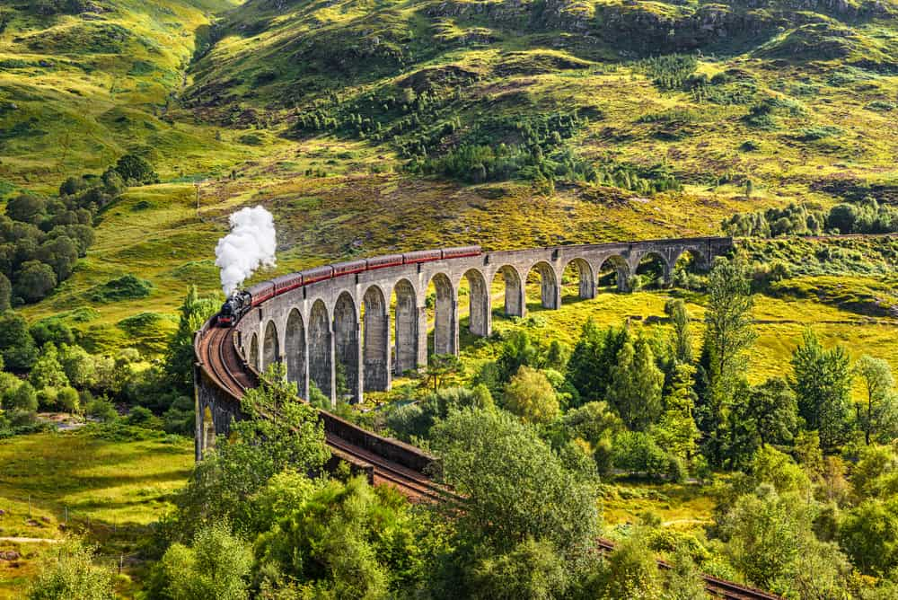 UK - Scotland - Glenfinnan Railway Viaduct in Scotland with the Jacobite steam train passing over
