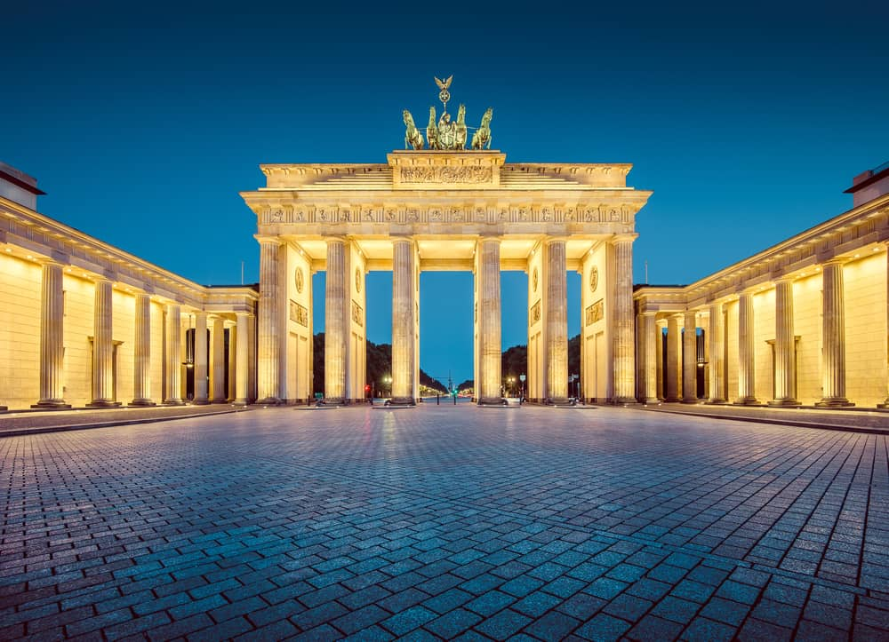 Germany - Berlin - Classic view of famous Brandenburger Tor (Brandenburg Gate), one of the best-known landmarks and national symbols of Germany, in twilight during blue hour at dawn, Berlin, Germany