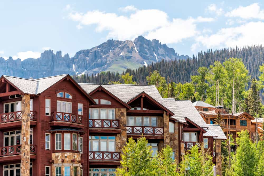 USA - Colorado - Telluride, Colorado small town Mountain Village in summer 2019 with view of San Juan Mountains and modern resort lodge apartment condo architecture
