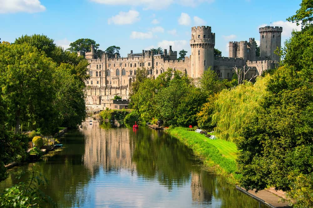 UK - England - Warwick castle from outside. It is a medieval castle built in 11th century and a major touristic attraction in UK nowadays. Sunny day