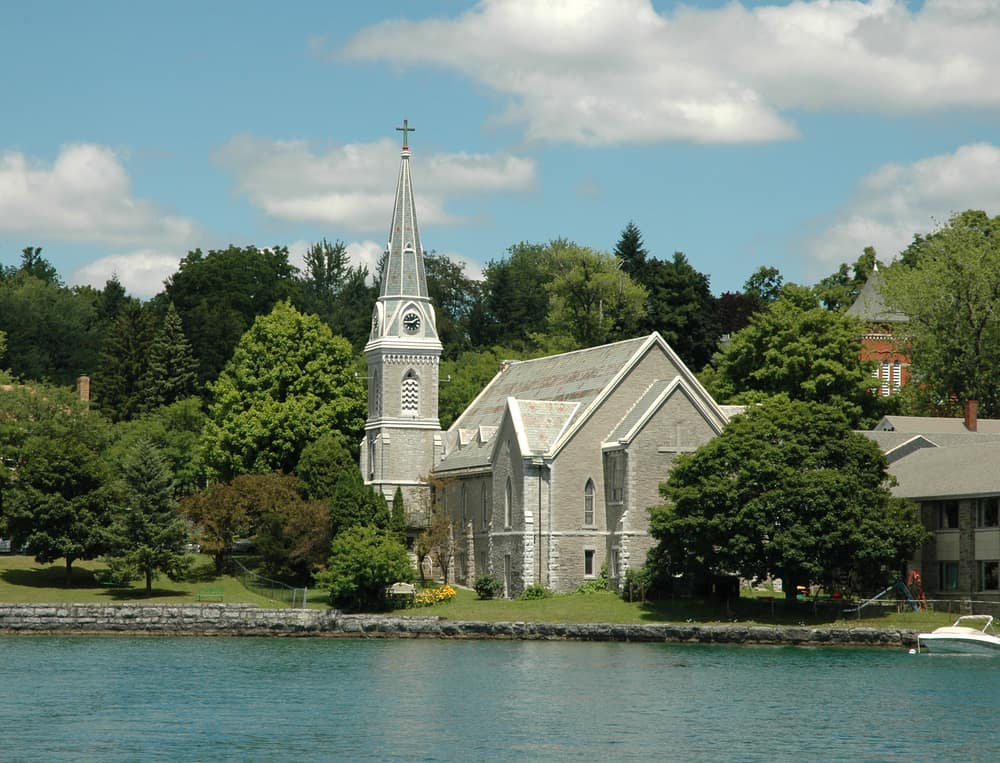 United States - New York - Lake front Church with Steeple and clock tower. Skaneateles Lake, Finger Lakes Region, Upstate New York.