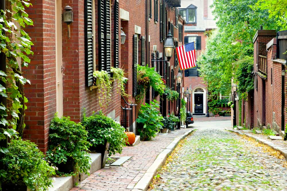 USA - Massachusets - Cobblestone street in Boston. Historic Acorn Street in Beacon Hill, called the most picturesque street in America, with a row of vintage red brick buildings.
