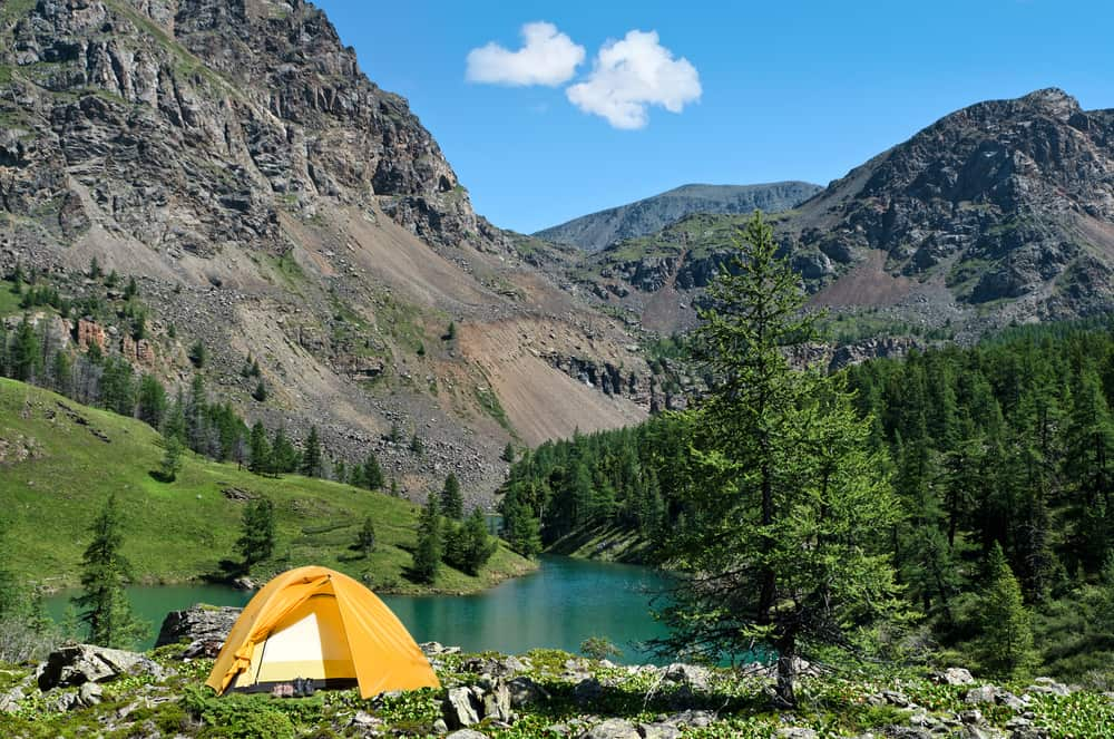 USA - Colorado - The Camping Tent near mountain lake in the summer