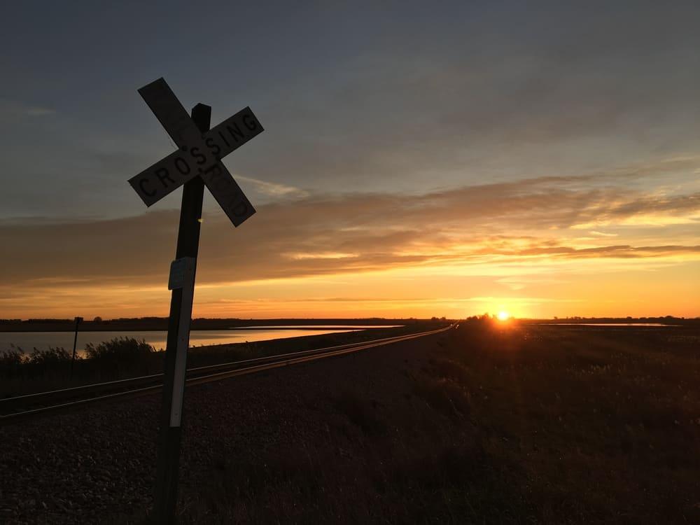 Railroad crossing sign at Desmet, South Dakota during sunrise
