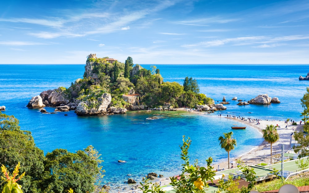 Isola Bella small island near Taormina, Sicily, southern Italy. Narrow path connects Isola Bella island to mainland Taormina beach surrounded by azure waters of the Ionian Sea.