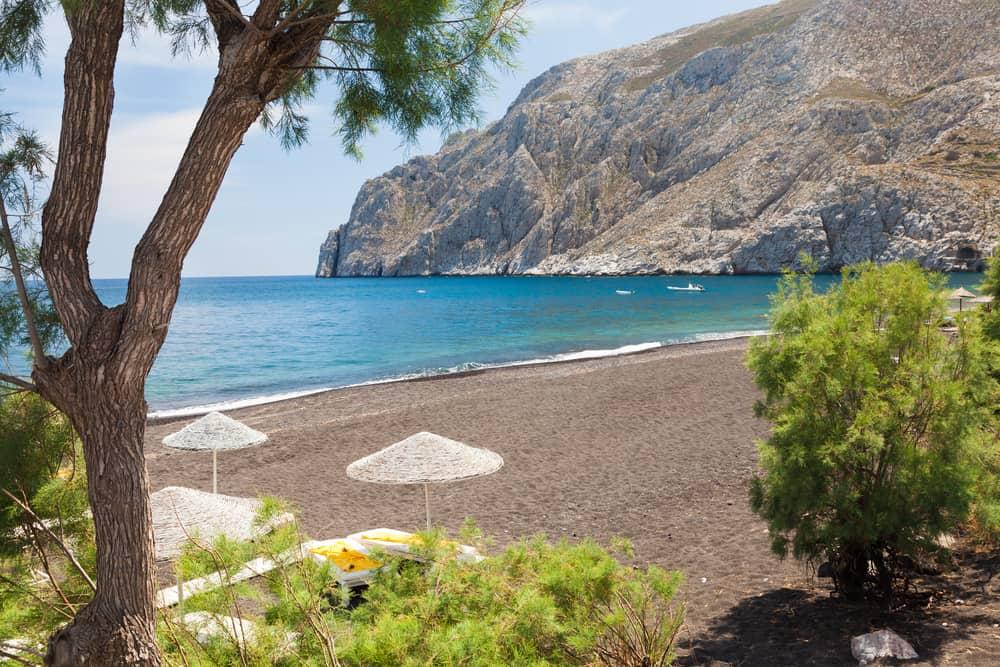 The black volcanic beach at Kamari Santorini Greece