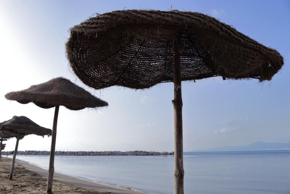La Goulette, Tunis: The traditional tunisian parasols on the beach at La Goulette that is near the city of Tunis in Tunisia