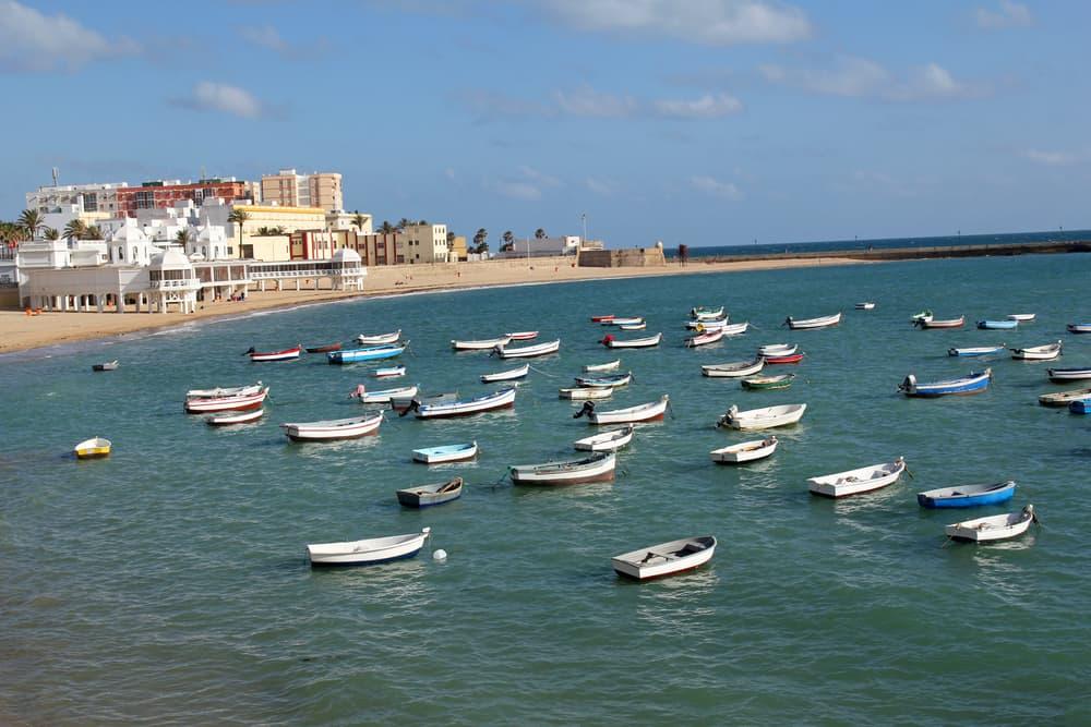 Caleta Beach and fishing boats in Cadiz, Spain