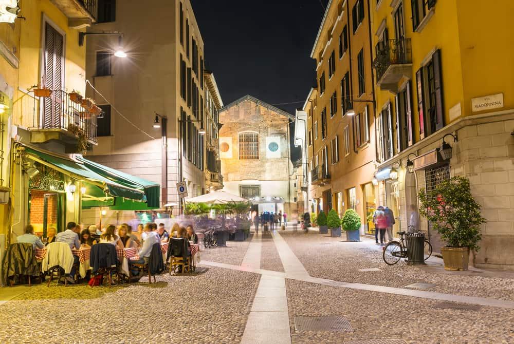 Old street in Milan at night, Italy. Architecture and landmarks of Milan. Nightlife of Milan