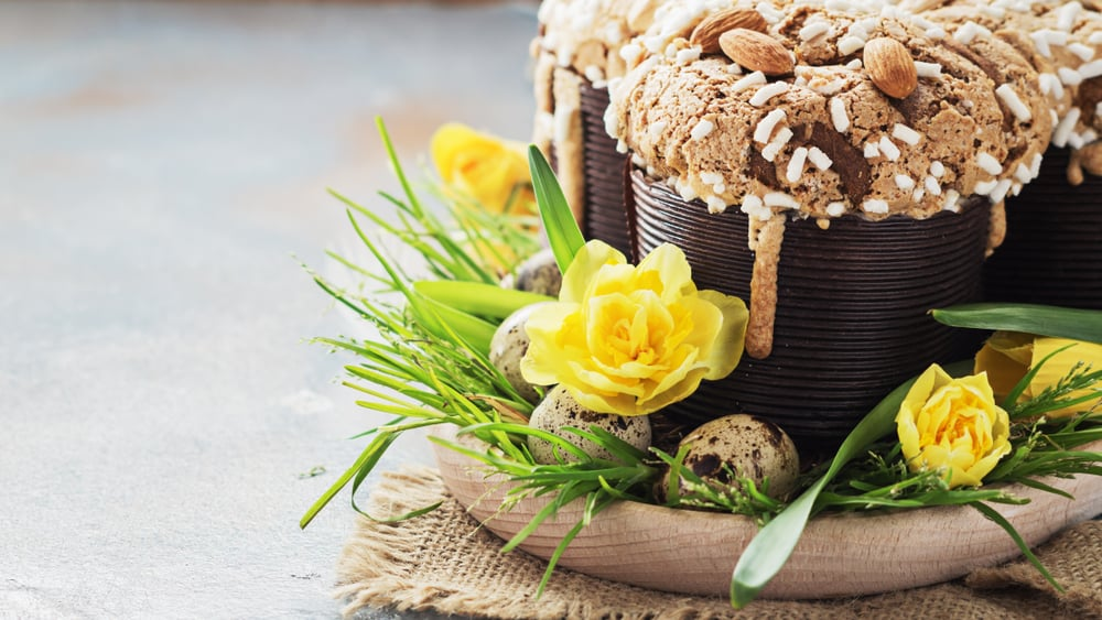 Italy - Milan - Colomba - italian easter dove cake on old rustic grey board. Selective focus, free text space.