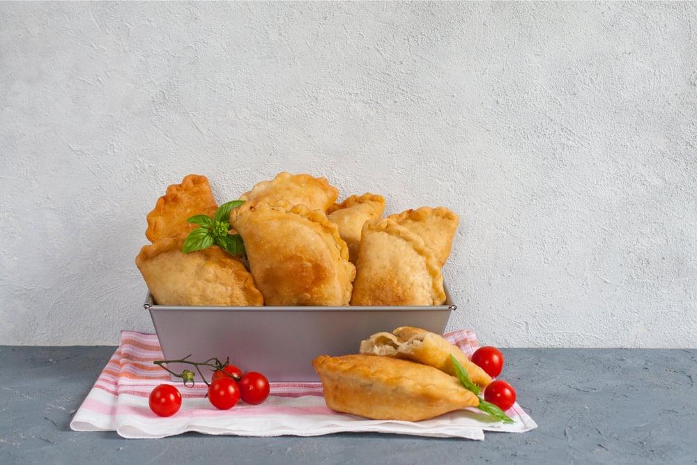 Italy - Milan - Homemade panzerotti - southern italian fried turnover. With mozzarella and mortadella filling.