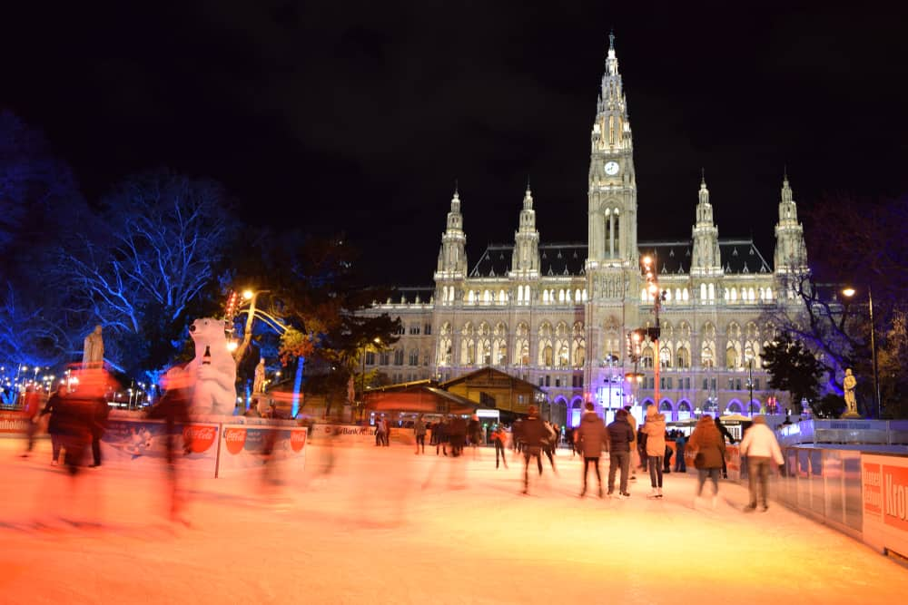 Ice Skating in front of Vienna City Hall (Christmas Time/ Holiday Celebrations) on a Cold December Night - Vienna, Austria