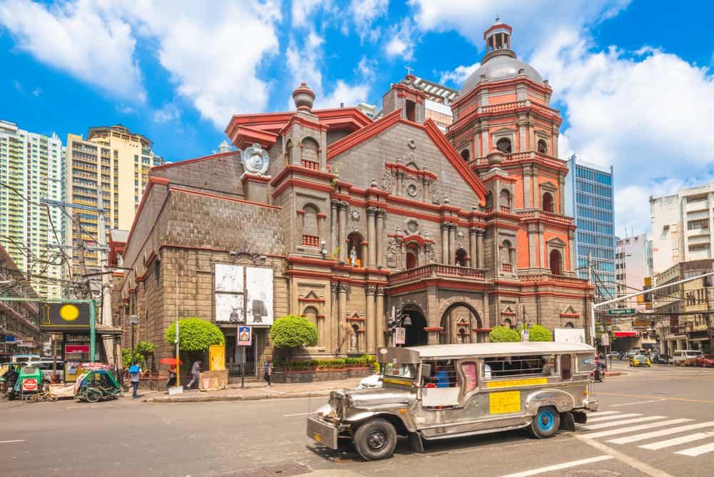 Minor Basilica of Saint Lorenzo Ruiz in manila with a Jeepney