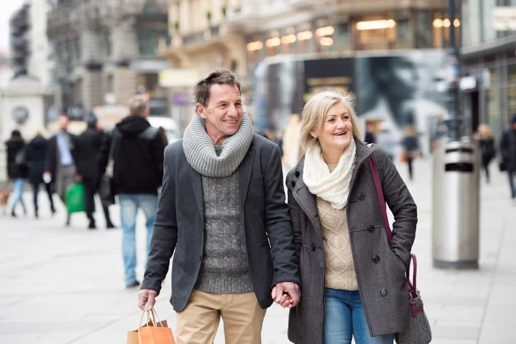 Senior couple shopping in centre of the city. Winter in Vienna Austriia