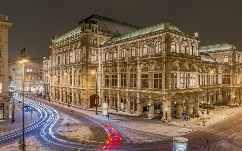 enna state opera in the winter night with long exposure shot while cars passing by. Austria, Europe, January 2017