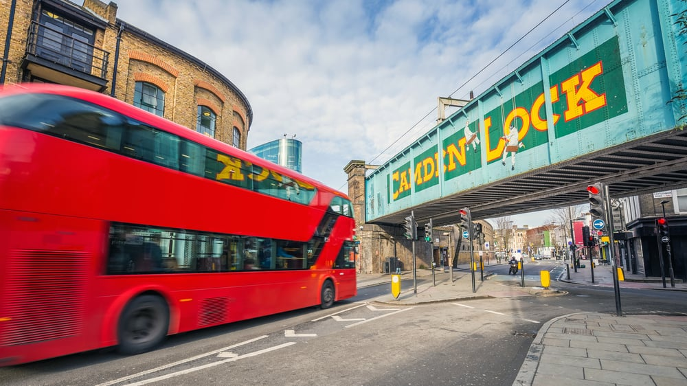 UK - England - London, England - Iconic red double decker bus on the move at the world famous stables market of Camden Town at daylight