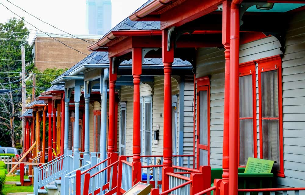 USA - Georgia - A row of colourful wooden porches of the social housing on Auburn Avenue, Atlanta, Sweet Auburn District, Atlanta USA these houses are directly opposit the house that Martin Luther King was born in.