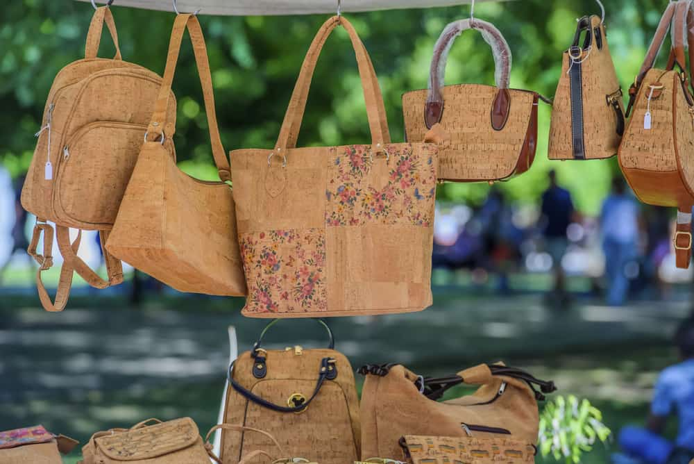 Portugal - Portuguese souvenirs, brown cork bags, at the street market at the Belem, Lisbon, Portugal.