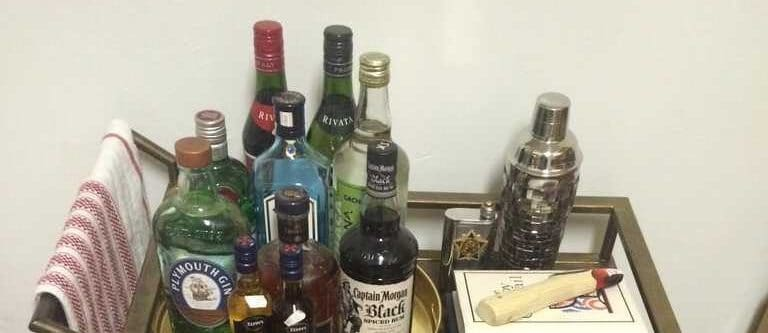 My own souvenir Cachaça on my bar cart in my apartment after my trip to Rio de Janeiro