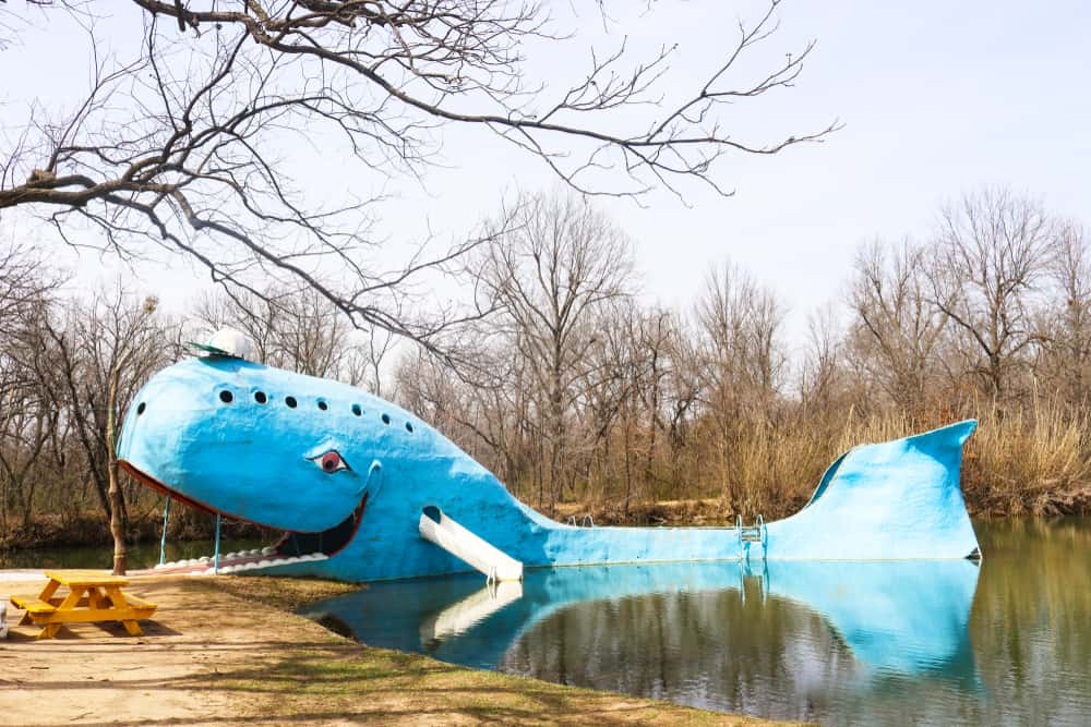 Oklahoma - Iconic huge Blue Whale roadside attraction by swimming hole on Route 66 in Oklahoma on a winter day