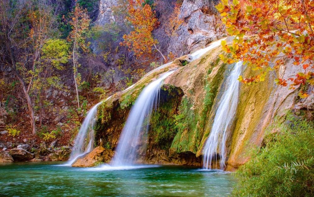 Color photograph of Turner Falls waterfall (near Davis, Oklahoma) during fall / autumn.